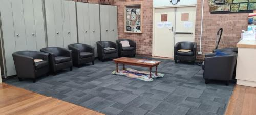 Carpeted area with lounge seating.